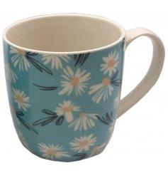 Perfect for that coffee or tea break! A blue hued ceramic mug with a cute daisy print