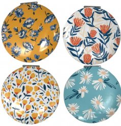 A mix of sweet floral themed compact mirrors, small enough to keep handy in a bag or pocket