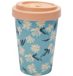 A bamboo based travel mug covered with a delicate daisy print surrounding it