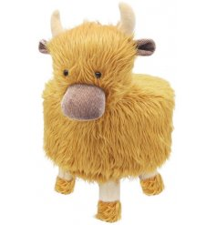 A large and plush woolly Highland Cow stool with simple wooden legs