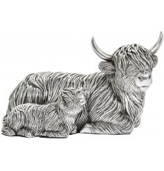 From the beautiful Leonardo Silver Art Range, a posed Highland Cow and Calf figure with intricate detailing