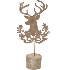 A stunningly designed metal Stag and wreath cut place setting on a wooden bark base