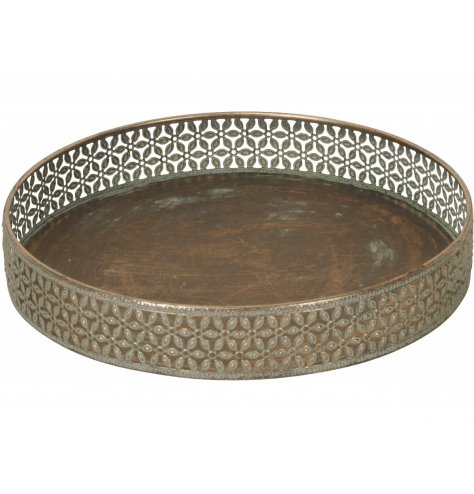 A large decorative metal tray with a tarnished bronzed colouring and stunning floral surround