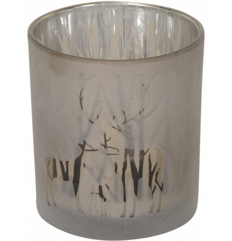 A gorgeously set glass tlight holder with a frosted front decal and silver tree inner lining