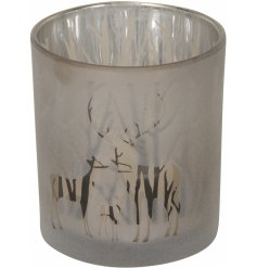 A gorgeously designed glass T-light holder featuring a frosted woodland reindeer scene and added tree inner decal