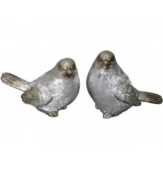 An assortment of posed bird Ornaments, beautifully detailed with shimmering silver tones