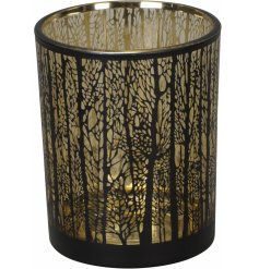 A gorgeously designed glass tlight holder with a silhouette tree decal and subtle gold inner lining