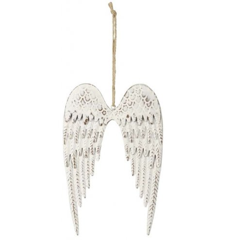 A simple pair of hanging metal angel wings set with a distressed white washed finish