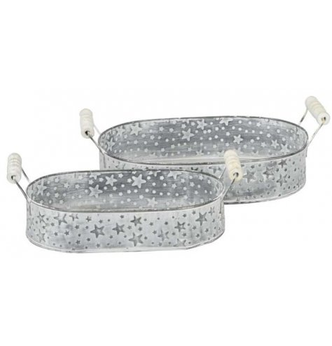 A set of 2 zinc trays covered with embossed star decals and a white washed finish