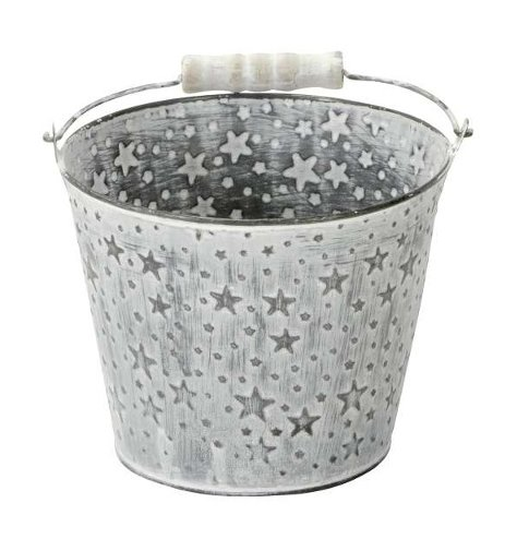 A zinc bucket covered with embossed star decals and a white washed finish