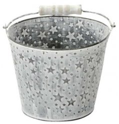 A small zinc planter featuring an embossed star decal, white washed finish and natural wooden handle