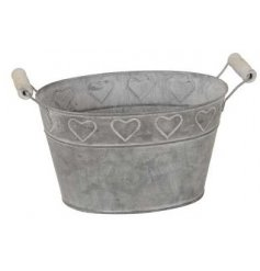 A rustic looking bucket complete with a chunky wooden handle and embossed heart motif surrounding it