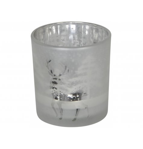 A decorative frosted glass candle holder set in a silver inner tone and etched reindeer decal