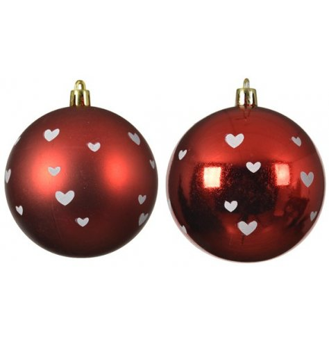 A mix of matt and shiny red shatterproof baubles displaying dotted white hearts on each