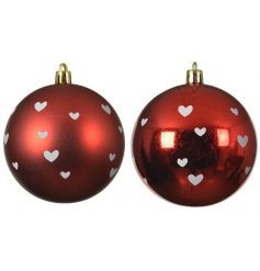 An assortment of shatterproof bauble set with shiny and matt red tones and little white hearts to finish each