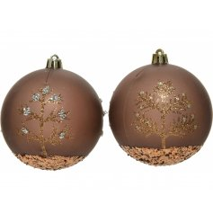 An assortment of luxe bronzed bauble with glittery touches and printed tree patterns