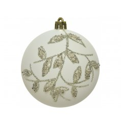 A white toned glass bauble beautifully set with a glittery beaded leaf pattern surrounding it