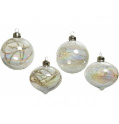 An assortment of shaped clear glass baubles, each filled with glittery touches and dried grass extras