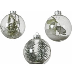 A stunning mix of clear glass baubles, each set with a glittery snow centre and added foliage