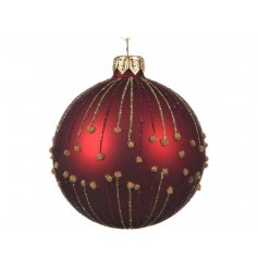 A stunning festive red toned glass bauble, set with a glittery trim surrounding it