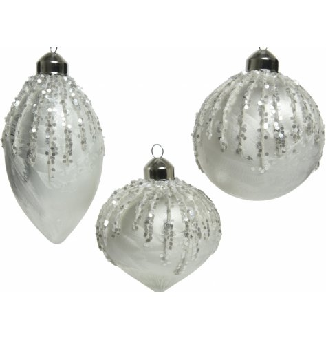 A mix of 3 shaped glass baubles, each set with a white base tone and added glittery accents