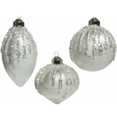 A gorgeous way to add a Wintered touch to your tree display at Christmas Time, a mix of  white bauble with glittery deca