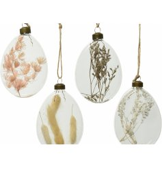 a mix of clear glass baubles each filled with natural grasses