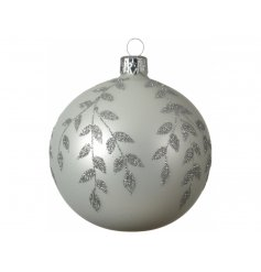 A white base toned glass baubles, featuring a beautiful glittery leaf decal