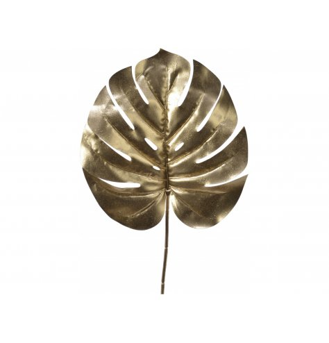 A gold toned plastic Monstera Leaf