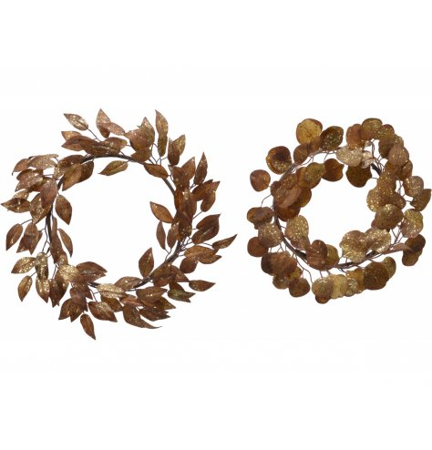 A mix of assorted leaf based wreaths with bronzed tones and added shimmery glitter