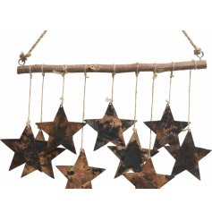 An overly rustic inspired hanging Star Display with jute string for hanging and a tarnished feature to each metal star