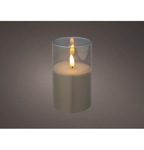A glass surrounded LED Wax Candle with a flameless flicker and warm glowing light
