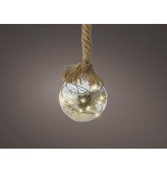 A clear glass bauble hung from a chunky rope hanger and perfectly set with Warm White Led lights