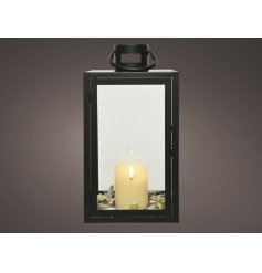 Sure to project a cosy candle flicker within any home, a large black framed lantern with an LED candle in the centre
