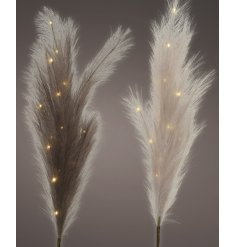 blush and deep pink toned artificial pampas stems with LED lights entwined