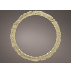 A stunningly simple round shaped wire LED decoration set with a Macrame tassel finish and warm glowing LED light