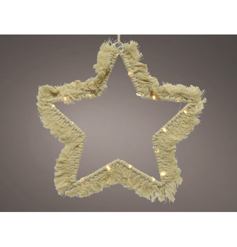 A minimalistic inspired macrame star with added warm glowing LED accents, a stunning accessory to bring to a Boho settin