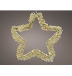 A stunningly simple star shaped wire LED decoration set with a Macrame tassel finish and warm glowing LED light