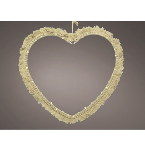 A minimalistic inspired macrame heart with added warm glowing LED accents, a stunning accessory to bring to a Boho setti