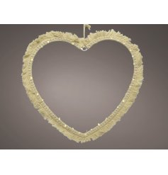 A stunningly simple heart shaped wire LED decoration set with a Macrame tassel finish and warm glowing LED light