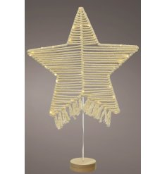 A stunning Macrame based Star Decoration with entwined lights, tassel touches and a wooden star to complete the look