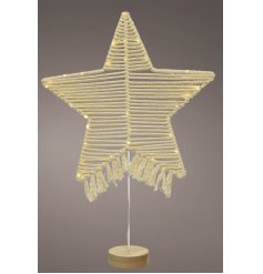 A gorgeously on Trend Star Decoration made from cotton macrame and entwined lights