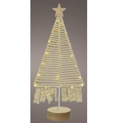 A stunning Macrame based Tree Decoration with entwined lights, tassel touches and a wooden star to complete the look