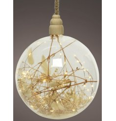 A gorgeously simple hanging glass bauble decoration, set with warm glowing LED Lights and filled with dried grass
