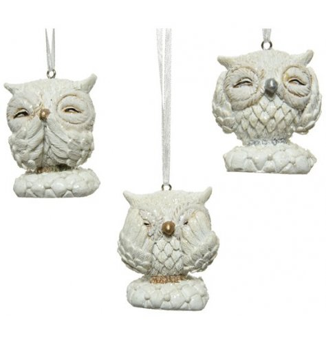 An assortment of sweetly posed hanging owl figures sprinkled with glitter and complete with See, Hear and Speak No evil