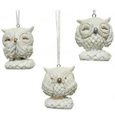 An adorable trio of hanging owl figures, each posed with a traditional See, Hear and Speak no evil poses