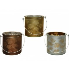 An assortment of Bronze, Brown and silver toned glass candle pots, each featuring an autumnal leaf print