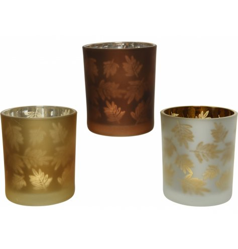 An assortment of beautiful Autumn colour inspired glass candle pots, each featuring a leaf motif decal