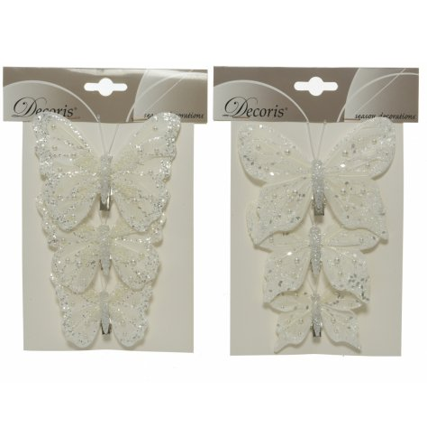 An assortment of butterfly clips, each with its own shaped wings and glittery finishes