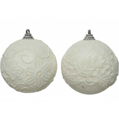A mix of foam based bauble, each coated in a shimmery white glitter and topped with a netted floral decal